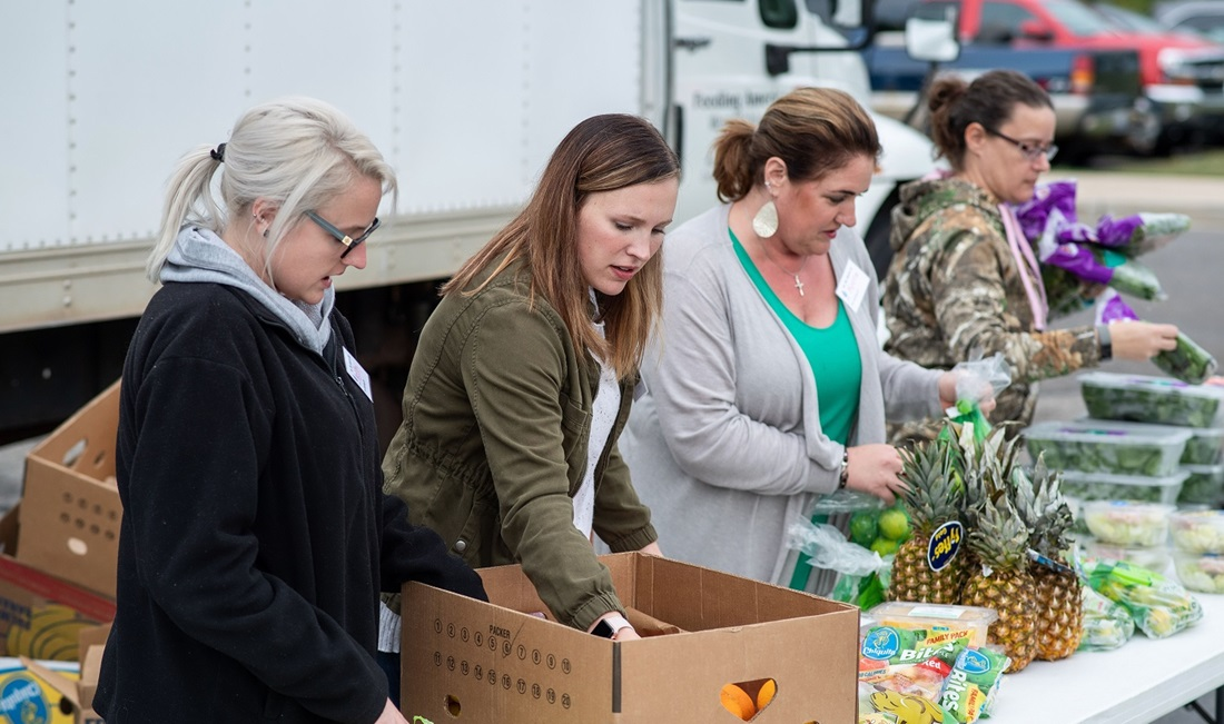 volunteers at Feeding America mobile food bank