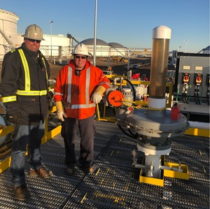 Workers at terminal with new valve